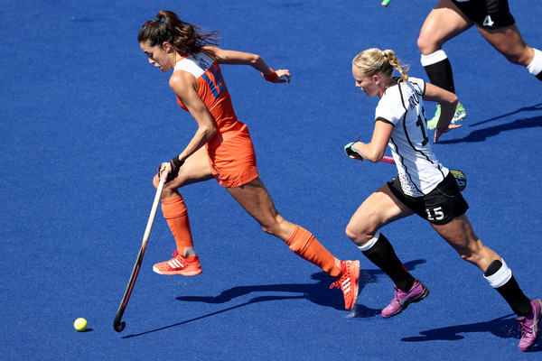 Hockey - Olympics: Day 8 [sports,hockey,field hockey,ball game,team sport,stick and ball games,player,sports equipment,ball hockey,tournament,naomi van as,hannah kruger,olympics,netherlands,germany,olympic hockey centre,brazil,rio de janeiro,womens pool a,match]