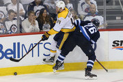 Blake Wheeler #26 of the Winnipeg Jets hits Mattias Ekholm #14 of the Nashville Predators in Game Six of the Western Conference Second Round during the 2018 NHL Stanley Cup Playoffs on May 7, 2018 at Bell MTS Place in Winnipeg, Manitoba, Canada. (Photo by Jason Halstead /Getty Images) *** Local Caption *** Blake Wheeler; Mattias Ekholm