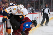 Roman Josi #59 of the Nashville Predators looses control of the puck against Jan Hejda #8 of the Colorado Avalanche at Pepsi Center on December 9, 2014 in Denver, Colorado. The Predators defeated the Avalanche 3-0.