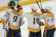 Goalie Pekka Rinne #35 of the Nashville Predators is congratulated by teammates Filip Forsberg #9, Mattias Elkholm #14 and Nick Bonino #13 after a 3-2 win against the Colorado Avalanche in Game Four of the Western Conference First Round during the 2018 NHL Stanley Cup Playoffs at the Pepsi Center on April 18, 2018 in Denver, Colorado.