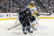 Blake Wheeler #26 of the Winnipeg Jets and Mattias Ekholm #14 of the Nashville Predators follow the puck in Game Three of the Western Conference Second Round during the 2018 NHL Stanley Cup Playoffs on May 1, 2018 at Bell MTS Place in Winnipeg, Manitoba, Canada. (Photo by Jason Halstead /Getty Images) *** Local Caption *** Blake Wheeler; Mattias Ekholm