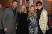 (L-R) NHL Player Mike Fisher, singer-songwriter Carrie Underwood,  Tracie Hamilton of J/P HRO and host Newman Arndt attend Nashville Shines for Haiti benefiting Sean Penn's J/P Haitian relief organization featuring Tim McGraw hosted and underwritten by Johnathon Arndt and Newman Arndt at the Arndt Estate on October 24, 2017 in Brentwood, Tennessee.