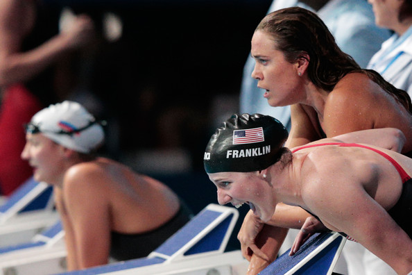 Swimming - 15th FINA World Championships: Day Nine [swimmer,recreation,muscle,swim cap,chest,competition event,headgear,sports,swimming,individual sports,teammate,natalie coughlin,swimming women,missy franklin,c,cheer,usa,palau sant jordi,fina world championships,freestyle]
