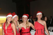 Simone Ballack,Magdalena Brzeska, Natascha Gruen and Monica Ivancan attend the Natascha & Gernot Gruen  'Golden Red Christmas Night' Party on December 19, 2012 in Munich, Germany.