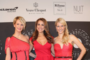 Monica Ivancan, Karen Webb and Natascha Gruen attend the Natascha & Gernot Gruen  'Golden Red Christmas Night' Party on December 19, 2012 in Munich, Germany.