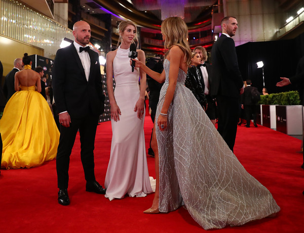 2019 Brownlow Medal [gown,red carpet,carpet,dress,flooring,event,bridal clothing,fashion,ceremony,wedding dress,nathan jones,jerri jones,brownlow medal,australia,melbourne,crown palladium,demons]