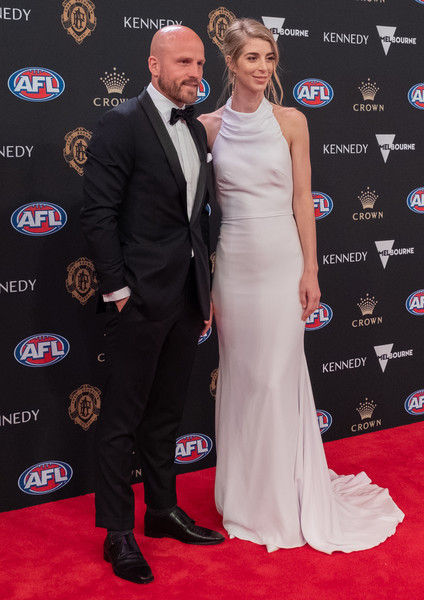 2019 Brownlow Medal [red carpet,carpet,dress,premiere,flooring,event,suit,fashion,formal wear,gown,nathan jones,jerri jones,brownlow medal,australia,melbourne,crown palladium,demons]