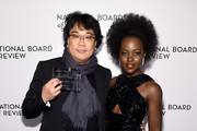 Bong Joon-Ho and Lupita Nyong'o attend The National Board of Review Annual Awards Gala at Cipriani 42nd Street on January 08, 2020 in New York City.