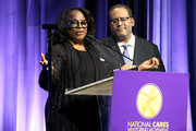 LaTanya Richardson Jackson and Dr. Michael Eric Dyson speak onstage during the National CARES Mentoring Movement 4th Annual For The Love Of Our Children Gala at The Ziegfeld Ballroom on February 11, 2019 in New York City.