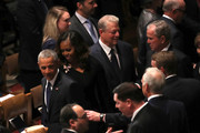 (L-R) Former U.S. President Barack Obama, Michelle Obama, former U.S. Vice President Al Gore, and former U.S. President George W. Bush arrive for the funeral service for U.S. Sen. John McCain at the National Cathedral  on September 1, 2018 in Washington, DC. The late senator died August 25 at the age of 81 after a long battle with brain cancer. McCain will be buried at his final resting place at the U.S. Naval Academy.