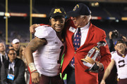 President Ted Tollner of the Holiday Bowl congratulates Rodney Smith #1 of the Minnesota Golden Gophers for winning the offensive  player of the game trophy after defeating the Washington State Cougars 17-12 in the Holiday Bowl at  at Qualcomm Stadium on December 27, 2016 in San Diego, California.