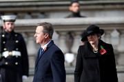 Britain's former Prime Ministers Theresa May (R) and David Cameron attend the National Service Of Remembrance at the Cenotaph in Westminster, amid the spread of coronavirus (COVID-19) disease on November 8, 2020 in London, England. Remembrance Sunday services are still able to go ahead despite the covid-19 measures in place across the various nations of the UK. Each country has issued guidelines to ensure the safety of those taking part.