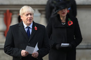 Former British Prime Minister Theresa May (R) and Britain's Prime Minister Boris Johnson (L) attend a National Service of Remembrance at the Cenotaph in Westminster, amid the spread of coronavirus (COVID-19) disease on November 8, 2020 in London, England. Remembrance Sunday services are still able to go ahead despite the covid-19 measures in place across the various nations of the UK. Each country has issued guidelines to ensure the safety of those taking part.