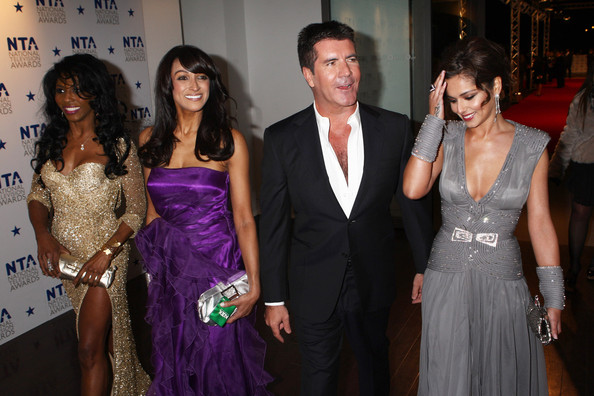 (UK TABLOID NEWSPAPERS OUT) Sinitta (L) Simon Cowell and Cheryl Cole (R) arrive at the National Television Awards held the at The O2 Arena on January 20, 2010 in London, England.