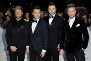 (L-R) Kian Egan, Shane Filan, Markus Feehily and Nicky Byrne from Westlife attend the National Television Awards held at the O2 Arena on January 22, 2019 in London, England.