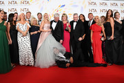 """Holly Willoughby, Phillip Schofield, Dr Ranj Singh, Ruth Langsford, Eamonn Holmes, Rochelle Humes, Lisa Snowdon and the cast of """"This Morning"""", pose in the winners room after winning the Live Magazine Show award  during the National Television Awards 2020 at The O2 Arena on January 28, 2020 in London, England."""