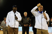 (L-R) Head coach John Thompson III of the Georgetown Hoyas, the honorable Ray Mabus the Secretary of the Navy and head coach Billy Donovan of the Florida Gators address the crowd to announce the game is canceled due to condensation on the court during the Navy-Marine Corps Classic aboard the USS Bataan at Mayport Naval Air Station on November 9, 2012 in Jacksonville, Florida.