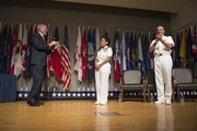 In this handout photo provided by the U.S. Navy, Secretary of the Navy Ray Mabus (L) and Chief of Naval Operations (CNO) Adm. Jonathan Greenert (R) applaud Adm. Michelle Howard (C) on her promotion to the rank of admiral at the Women in Military Service for America Memorial on July 1, 2014 in Washington, D.C. Howard is the first woman to be promoted to the rank of admiral in the history of the Navy and will assume the duties and responsibilities as the 38th Vice Chief of Naval Operations from Adm. Mark Ferguson.