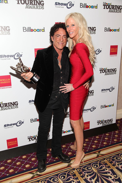 Neal schon neal schon of journey and michaele salahi attend the 2011