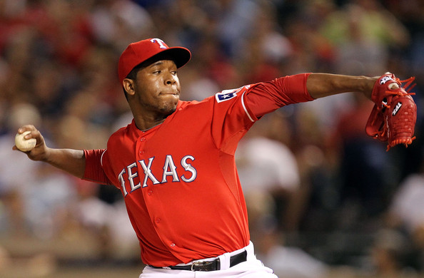 Neftali Feliz Pitcher Neftali Feliz #30 of the Texas Rangers throws against the New York Yankees at Rangers Ballpark in Arlington on May 7, 2011 in Arlington, Texas.