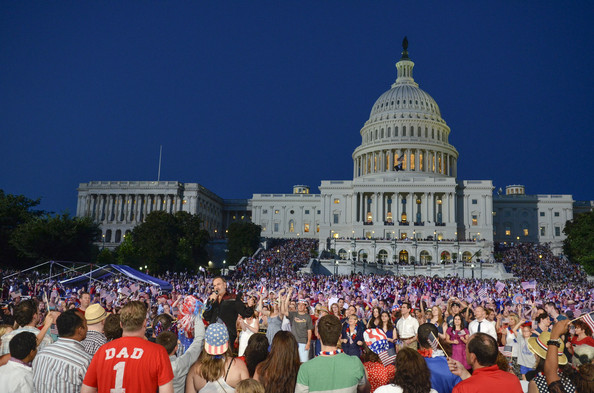 A Capitol Fourth Independence Day Concert [a capitol fourth,crowd,people,event,tourism,audience,city,architecture,festival,night,leisure,neil diamond,lawn,washington dc,us capitol,independence day concert]
