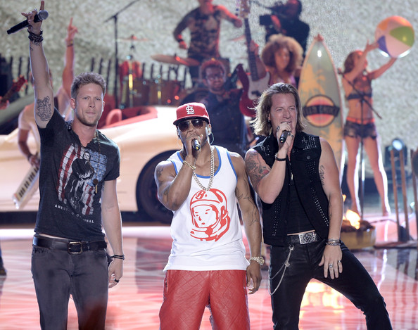 Nelly Rapper Nelly (C) and singers Tyler Hubbard and Brian Kelley of