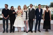 "(FromL) German editor Matthew Newman, US composer Cliff Martinez, Australian actress Bella Heathcote, US actress Elle Fanning, Danish director Nicolas Winding Refn, US actor Karl Glusman and Danish producer Lene Borglum pose on May 20, 2016 during a photocall for the film ""The Neon Demon"" at the 69th Cannes Film Festival in Cannes, southern France.  / AFP / ANNE-CHRISTINE POUJOULAT"