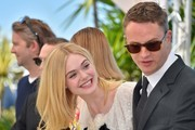 "Danish director Nicolas Winding Refn (R) and US actress Elle Fanning pose on May 20, 2016 during a photocall for the film ""The Neon Demon"" at the 69th Cannes Film Festival in Cannes, southern France.  / AFP / LOIC VENANCE"