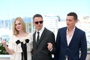 "Elle Fanning, director Nicolas Winding Refn and actor Karl Glusman attend the ""The Neon Demon"" photocall during the 69th annual Cannes Film Festival at Palais des Festivals on May 20, 2016 in Cannes, France."