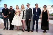 "(L-R) Editor Matthew Newman, composer Cliff Martinez, actors Bella Heathcote, Elle Fanning, director Nicolas Winding Refn, actor Karl Glusman and producer Lene Borglum attend the ""The Neon Demon"" photocall during the 69th annual Cannes Film Festival at Palais des Festivals on May 20, 2016 in Cannes, France."