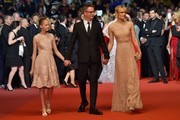 "Danish director Nicolas Winding Refn (C) poses with his wife Liv Corfixen (R) and their daughter Lola as they arrive on May 20, 2016 for the screening of the film ""The Neon Demon"" at the 69th Cannes Film Festival in Cannes, southern France.  / AFP / LOIC VENANCE"