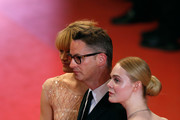 """Director Nicolas Winding Refn (C), Liv Corixen (L) and actress Elle Fanning (R) attend """"The Neon Demon"""" Premiere during the 69th annual Cannes Film Festival at the Palais des Festivals on May 20, 2016 in Cannes, France."""