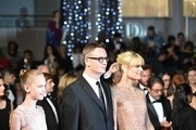 "Danish director Nicolas Winding Refn (C) arrives on May 20, 2016 with his wife Liv Corfixen (R) and daughter Lola for the screening of the film ""The Neon Demon"" at the 69th Cannes Film Festival in Cannes, southern France.  / AFP / ALBERTO PIZZOLI"