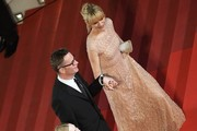 "Danish director Nicolas Winding Refn (C) arrives with his wife Liv Corfixen (R) and US actress Elle Fanning on May 20, 2016 for the screening of the film ""The Neon Demon"" at the 69th Cannes Film Festival in Cannes, southern France.  / AFP / ANNE-CHRISTINE POUJOULAT"