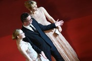"Danish director Nicolas Winding Refn (C) poses with his wife Liv Corfixen (R) and US actress Elle Fanning as they arrive on May 20, 2016 for the screening of the film ""The Neon Demon"" at the 69th Cannes Film Festival in Cannes, southern France.  / AFP / ANNE-CHRISTINE POUJOULAT"
