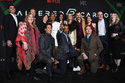 "(L-R) Bill Bost, Alison Schapker, David Ellison, Dana Goldberg, Will Yun Lee, Simone Missick, Anthony Mackie, Renée Elise Goldsberry, Dina Shihabi, Torben Liebrecht, Chris Conner, Lela Loren, Peter Friedlander, and Laura Delahaye attend Netflix's ""Altered Carbon"" Season 2 Photo Call at AMC Lincoln Square Theater on February 24, 2020 in New York City."