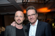 """Aaron Paul (L) and Bryan Cranston attend the after party for the World Premiere of """"El Camino: A Breaking Bad Movie"""" at Baltaire Restaurant on October 07, 2019 in Los Angeles, California."""