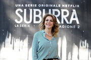"""Claudia Gerini attends a photocall for Netflix """"Suburra"""" The Series, season 2 at Casa del Cinema on February 20, 2019 in Rome, Italy."""