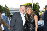 "(L-R) Netflix Chief Content Officer Ted Sarandos and Jennifer Aniston attend the Netflix World Premiere Of ""Murder Mystery"" at Village Theatre Westwood on June 10, 2019 in Los Angeles, California."