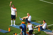 Ron Vlaar (L) and Arjen Robben (top right) look for their family during the Netherlands training session at the 2014 FIFA World Cup Brazil held at the Estadio Jose Bastos Padilha Gavea on June 14, 2014 in Rio de Janeiro, Brazil.