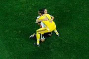 Maxi Rodriguez of Argentina celebrates with goalkeeper Sergio Romero after making his penalty kick to defeat the Netherlands in a shootout during the 2014 FIFA World Cup Brazil Semi Final match between the Netherlands and Argentina at Arena de Sao Paulo on July 9, 2014 in Sao Paulo, Brazil.