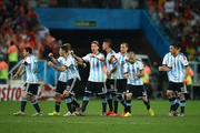 (L-R) Lionel Messi, Pablo Zabaleta, Martin Demichelis, Lucas Biglia, Marcos Rojo, Rodrigo Palacio, Javier Mascherano, Ezequiel Garay and Maxi Rodriguez of Argentina react after a made penalty kick by teammate Sergio Aguero (not pictured) during the 2014 FIFA World Cup Brazil Semi Final match between the Netherlands and Argentina at Arena de Sao Paulo on July 9, 2014 in Sao Paulo, Brazil.
