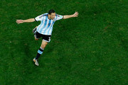Maxi Rodriguez of Argentina celebrates scoring his penalty kick to defeat the Netherlands in a shootout during the 2014 FIFA World Cup Brazil Semi Final match between the Netherlands and Argentina at Arena de Sao Paulo on July 9, 2014 in Sao Paulo, Brazil.