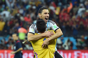 Sergio Romero and Maxi Rodriguez of Argentina celebrate defeating the Netherlands in a shootout during the 2014 FIFA World Cup Brazil Semi Final match between the Netherlands and Argentina at Arena de Sao Paulo on July 9, 2014 in Sao Paulo, Brazil.
