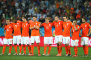 Jordy Clasie, Georginio Wijnaldum, Daryl Janmaat, Klaas-Jan Huntelaar, Dirk Kuyt, Ron Vlaar, Stefan de Vrij, Wesley Sneijder and Daley Blind of the Netherlands look up during a penalty shootout during the 2014 FIFA World Cup Brazil Semi Final match between the Netherlands and Argentina at Arena de Sao Paulo on July 9, 2014 in Sao Paulo, Brazil.