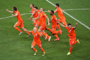 Daley Blind, Wesley Sneijder, Stefan de Vrij, Arjen Robben, Ron Vlaar, Jeremain Lens, Klaas-Jan Huntelaar and Robin van Persie of the Netherlands celebrate after defeating Costa Rica in a penalty shootout during the 2014 FIFA World Cup Brazil Quarter Final match between the Netherlands and Costa Rica at Arena Fonte Nova on July 5, 2014 in Salvador, Brazil.
