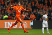 Robin van Persie of the Netherlands celebrates as he scores their second goal and his 50th in international matches during the UEFA EURO 2016 qualifying Group A match between the Netherlands and the Czech Republic at Amsterdam Arena on October 13, 2015 in Amsterdam, Netherlands.