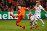 Robin van Persie of the Netherlands holds off Vaclav Prochazka of the Czech Republic as he scores their second goal and his 50th in international matches during the UEFA EURO 2016 qualifying Group A match between the Netherlands and the Czech Republic at Amsterdam Arena on October 13, 2015 in Amsterdam, Netherlands.