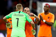Wesley Sneijder of the Netherlands is greeted by Jasper Cillessen of the Netherlands, as Wesley Sneijder is subsituted off during his last ever match for the Netherlands during the International Friendly match between Netherlands and Peru at Johan Cruyff Arena on September 6, 2018 in Amsterdam, Netherlands.