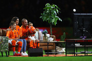 Wesley Sneijder of the Netherlands with Yolanthe Sneijder-Cabau, Xess Xava and Jessey Sneijder watch highlights package of his career on a TV screen in the middle of the field or pitch after the International friendly match match between The Netherlands and Peru at the Johan Cruijff Arena on September 06, 2018 in Amsterdam, The Netherlands.